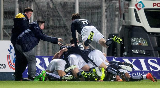 Game-changer: Falkirk's Bob McHugh (hidden) is bundled by team-mates after scoring his side's third goal