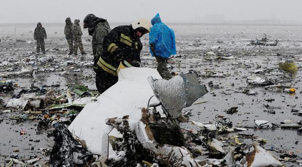 Russian Emergency Ministry employees investigate the wreckage of a crashed plane at the Rostov-on-Don airport, about 950 kilometers (600 miles) south of Moscow, Russia Saturday, March 19, 2016. (AP Photo)