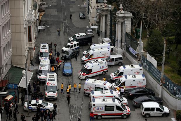 Security officials and ambulances at the scene of an explosion, on a street, in Istanbul, Turkey, Saturday, March 19, 2016. (AP Photo/Emrah Gurel)