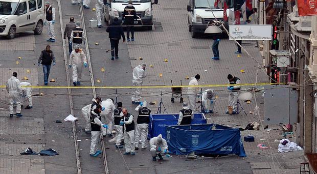 The forensic team at the scene of an explosion, on a street, in Istanbul, Turkey, Saturday, March 19, 2016. (Ismail Coskun, IHA via AP)