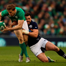 On the ball: Andrew Trimble charges ahead