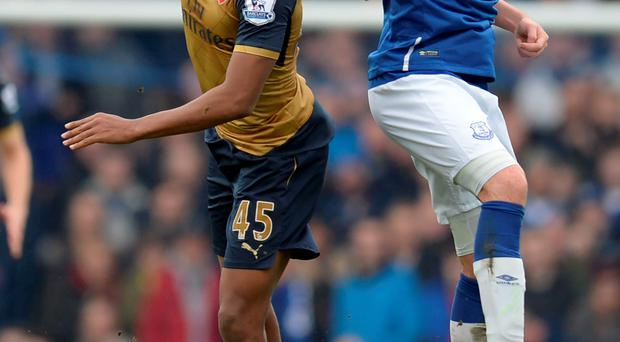 Heads up: Alex Iwobi battles with James McCarthy