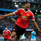 Goal king: Manchester United's Marcus Rashford celebrates his winner against Manchester City at the Etihad Stadium