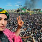 A woman makes the V-sign as Turkish Kurds gather as part of Newroz celebrations in Diyarbakir, on March 21, 2016. AFP/Getty Images