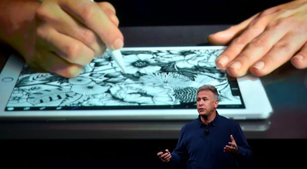 Apple Sr. Vice President of Marketing Phil Schiller introduces the new iPad during a media event at Apple headquarters in Cupertino, California on March 21, 2016. / AFP PHOTO / Josh EdelsonJOSH EDELSON/AFP/Getty Images