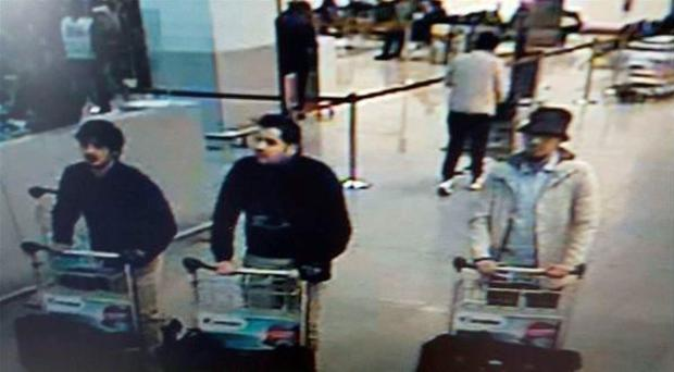 Belgian federal police released this image of Brussels bomb suspects. The two men on the left, each wearing a single black glove, are thought to be suicide bombers, while the third is thought to be on the run.