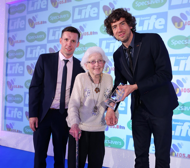 Special night: Gary Lightbody of Snow Patrol and Sunday Life Editor Martin Breen with Unsung Hero winner Patricia Nevines at the 2015 awards.