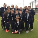 Lucky 13: The 13 girls from Methody, who are also part of the Belfast Harlequins club, show off their all-Ireland schools' medals