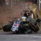 Collision course: McLaren Honda's Fernando Alonso crashes into the wall after colliding with Esteban Gutierrez yesterday