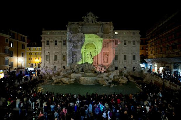 The Belgian flag is projected on Rome's historical Trevi Fountain to honor the victims of the deadly attacks at Brussels airport and subway, Tuesday, March 22, 2016. (AP Photo/Andrew Medichini)