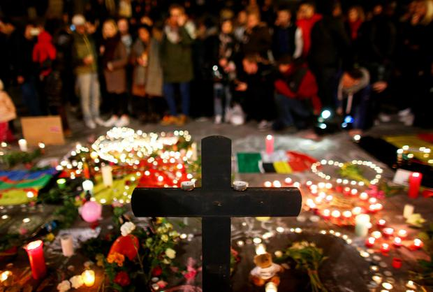 People light candles at the Place de la Bourse following today's attacks on March 22, 2016 in Brussels, Belgium. (Photo by Carl Court/Getty Images)
