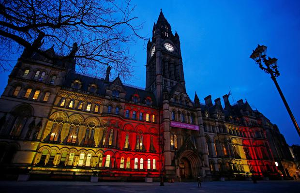 Manchester Town Hall displays the colours of the Belgium Flag as a tribute following yesterday's terrorist attacks in Brussels. PA