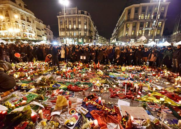 Hundreds of people come together at Place de la Bourse to mourn on Wednesday evening, March 23, 2016 (AP Photo/Martin Meissner)