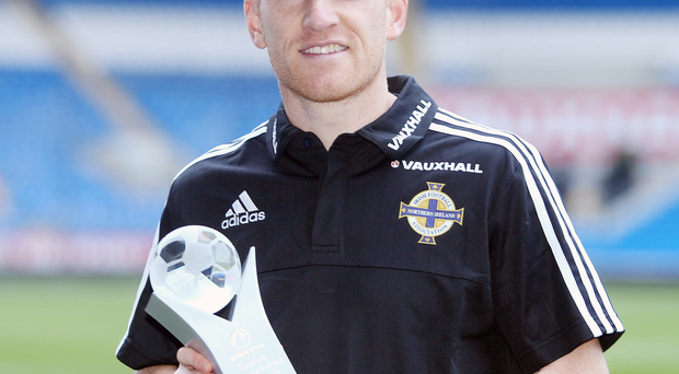 Prize guy: Steven Davis lifts his NI Player of the Year crown