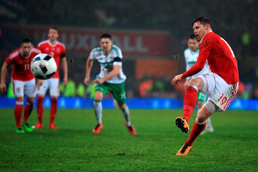 Wales' Simon Church scores his sides first goal of the game from t he penlaty spot during the International Friendly at the Cardiff City Stadium, Cardiff. PA