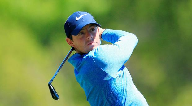 In form: Rory McIlroy hits his tee shot on the third hole yesterday