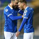 It's in: Linfield's Andrew Waterworth celebrates opening the scoring for Linfield last night at Windsor Park