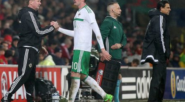Northern Ireland's Kyle Lafferty is brought off by manager Michael O'Neill.