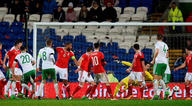Get in: Craig Cathcart (20) pounces to fire Northern Ireland in front