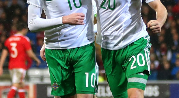 Friendly fire: Kyle Lafferty and goal scorer Craig Cathcart