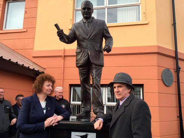James Connolly Herron (right) unveils a new statue with Northern Ireland Culture Minister Caral Ni Chuilin, for his great grandfather James Connolly, one of the 1916 Easter Rising leaders on Falls Road, Belfast. PA