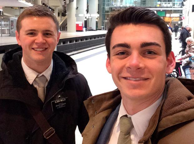 This undated photo provided by Chad Wells shows Mormon missionaries Mason Wells, 19, of Sandy, Utah, left, and Joseph Empey, 20, of Santa Clara, Utah. They both were injured in Tuesday's explosion at the Brussels airport. (Joseph Empey/Chad Wells via AP)