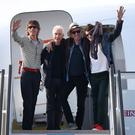(L-R) Mick Jagger, Charlie Watts, Keith Richards and Ronnie Wood of the Rolling Stones wave as they exit their plane after landing at the Jose Marti International Airport on March 24, 2016 in Havana, Cuba. (Photo by Joe Raedle/Getty Images)