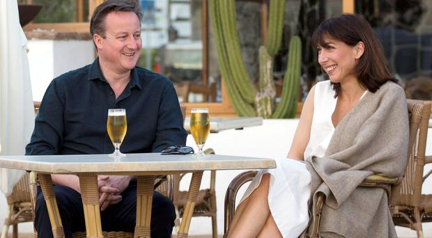 Prime Minister David Cameron and his wife Samantha pose for a photograph during their holiday in Playa Blanca, Lanzarote.