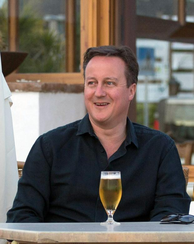 Prime Minister David Cameron pose for a photograph during his holiday with his wife Samantha in Playa Blanca, Lanzarote.