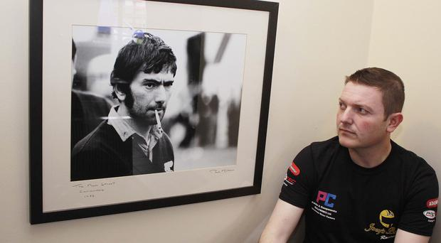 Picture perfect: Gary Dunlop looks at a photo of his late father Joe
