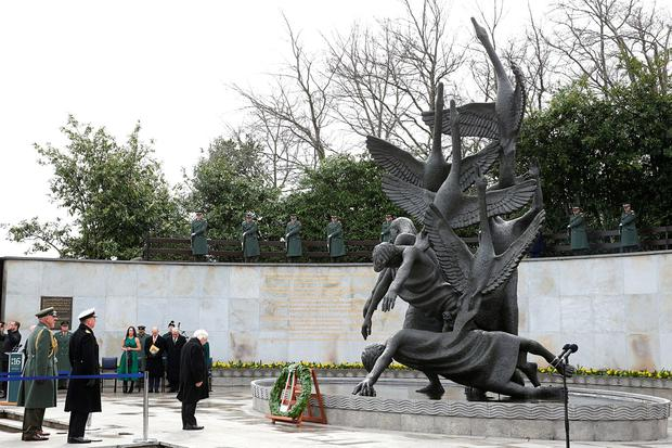 Irish President Michael D Higgins (right) lays a wreath at the Garden of Remembrance in Dublin on Saturday. Photo: Brian Lawless/PA Wire