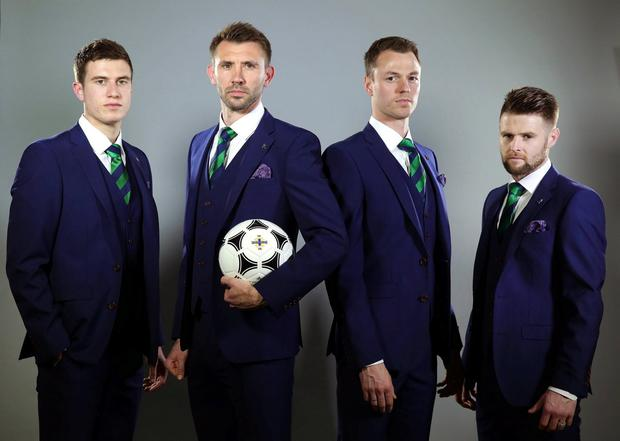The new, tailor-made suit which the Northern Ireland players and officials will be wearing in France this summer has been officially unveiled by Bogart. Pictured wearing the team suit are Northern Ireland team-mates Paddy McNair, Gareth McAuley, Jonny Evans and Oliver Norwood. Picture by Kelvin Boyes / Press Eye.