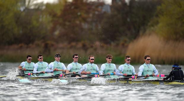 The Cambridge Blue Boat crew on their way to victory in the Boat Race