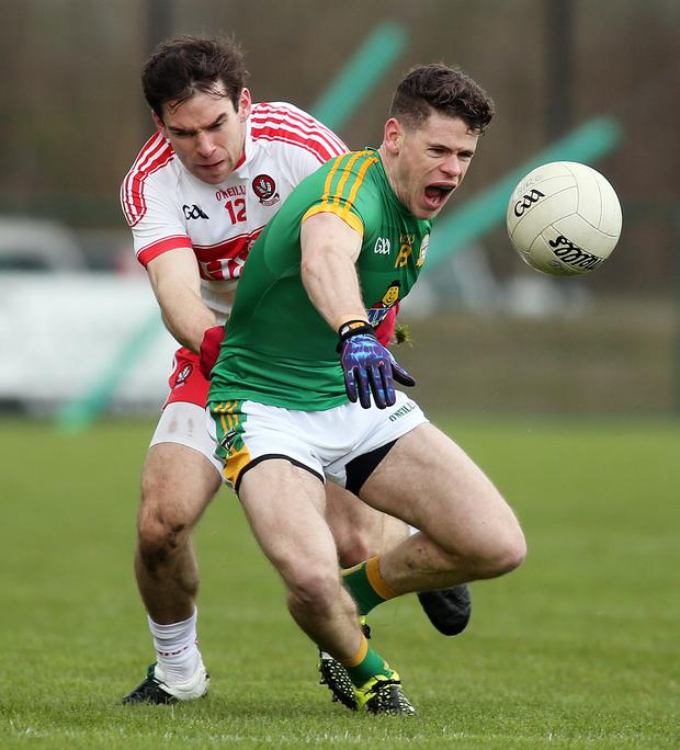 Race is on: Meath's Donal Lenin battles with Benny Heron