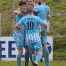 Big win: Warrenpoint Town players celebrate on Saturday
