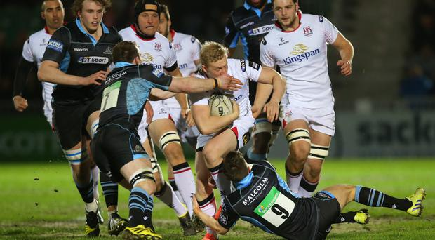 No way through: Stuart Olding finds his route blocked during Ulster's defeat to Glasgow at Scotstoun on Friday night