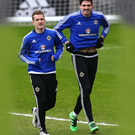 Raring to go: Steven Davis and Kyle Lafferty train at Windsor Park ahead of tonight's clash with Slovenia