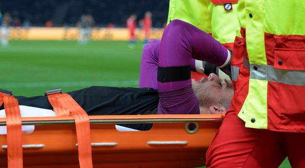 Jack Butland is stretchered off with a broken ankle during England's friendly against Germany