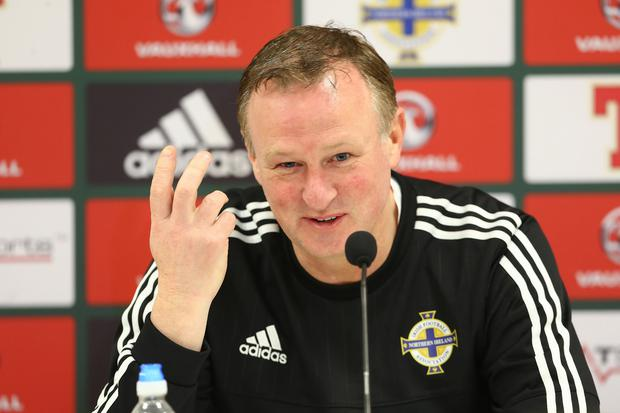 Looking up: Michael O'Neill has been given hope by England's performance against Germany