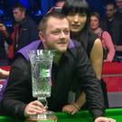 Glittering prize: Mark Allen celebrates his Players Championship success with his wife Kyla in Manchester last night