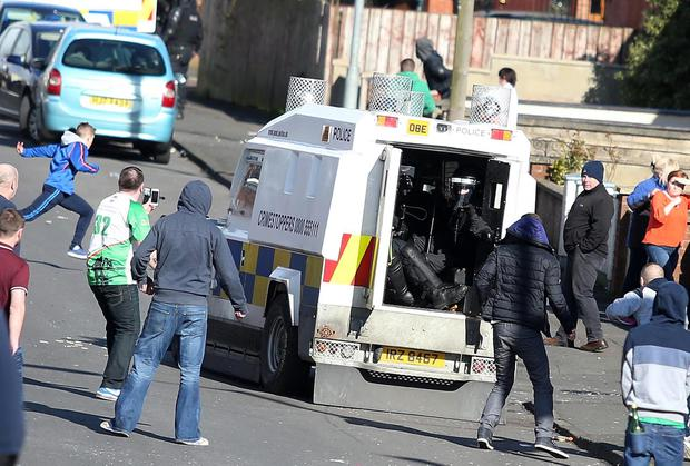 Trouble starts in the Lake Street area of Lurgan as youths throw stones at police on Monday afternoon. Picture by Jonathan Porter/PressEye