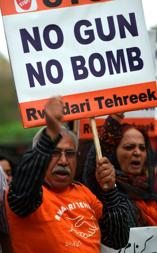 Pakistani civil society activists shout slogans at the suicide blast site in Lahore on March 28, 2016. AFP/Getty Images