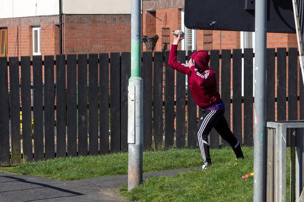 A young male in the Kilwilke estate, as a disturbance comes hours after Protestant Loyal Order the Apprentice Boys of Derry paraded through Lurgan in Northern Ireland. Photo: Liam McBurney/PA