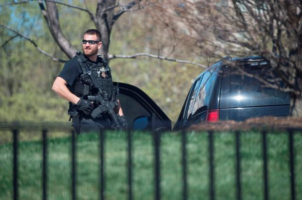 A US Secret Service agent stands guard at the White House in Washington, DC, on March 28, 2016. AFP/Getty Images