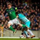 Northern Ireland's Stephen Davis (left) reacts to a challenge from Slovenia's Jokic Bojan during an International Friendly at Windsor Park, Belfast. PA
