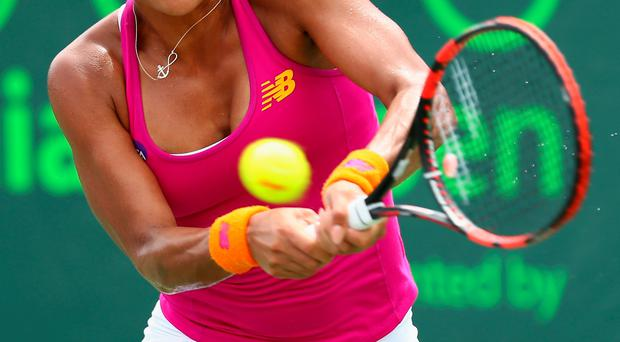 Bowing out: Heather Watson was beaten by Simona Halep