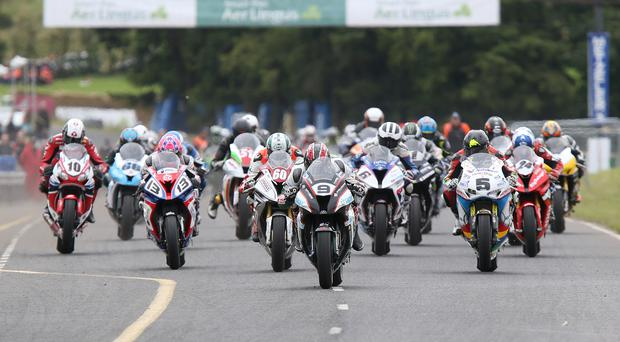 Ian Hutchinson (PBM Kawasaki) leads the field at the start of the Superbike race at the Ulster Grand Prix. Pacemaker Stephen Davidson