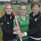 Family affair: Carolyn Burns (right) plays alongside daughters Rachel (centre) and Alex (left) at Senior One side Rainey