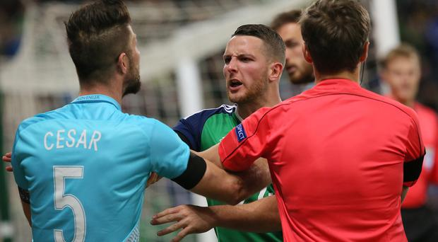 Thick of the action: Conor Washington stands up to Slovenia goalkeeper Jan Oblak on Monday night