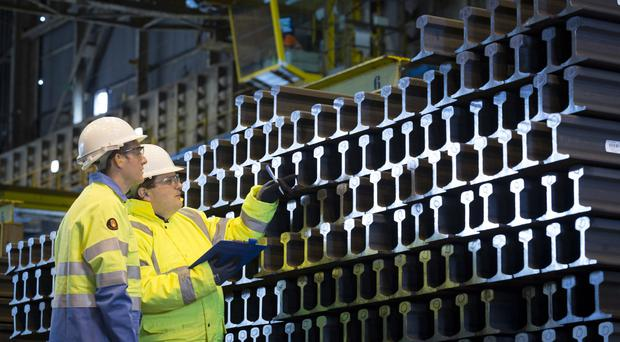 Tata Steel workers inspect rail products